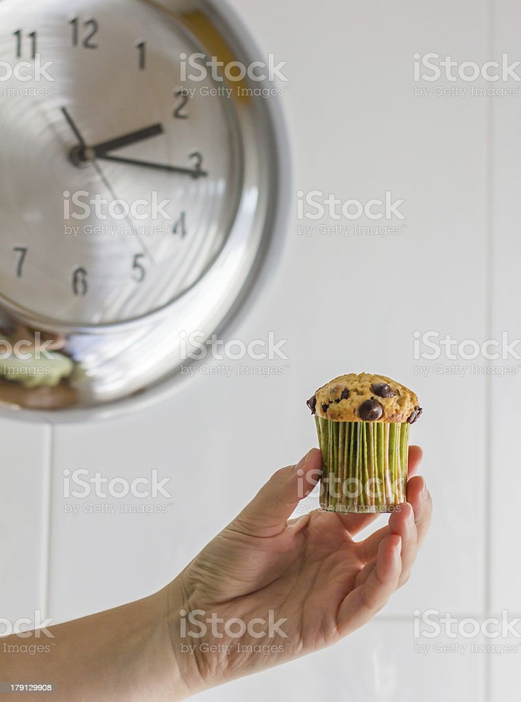 Nice girl hand taking chocolate chip muffin at lunch royalty-free stock photo