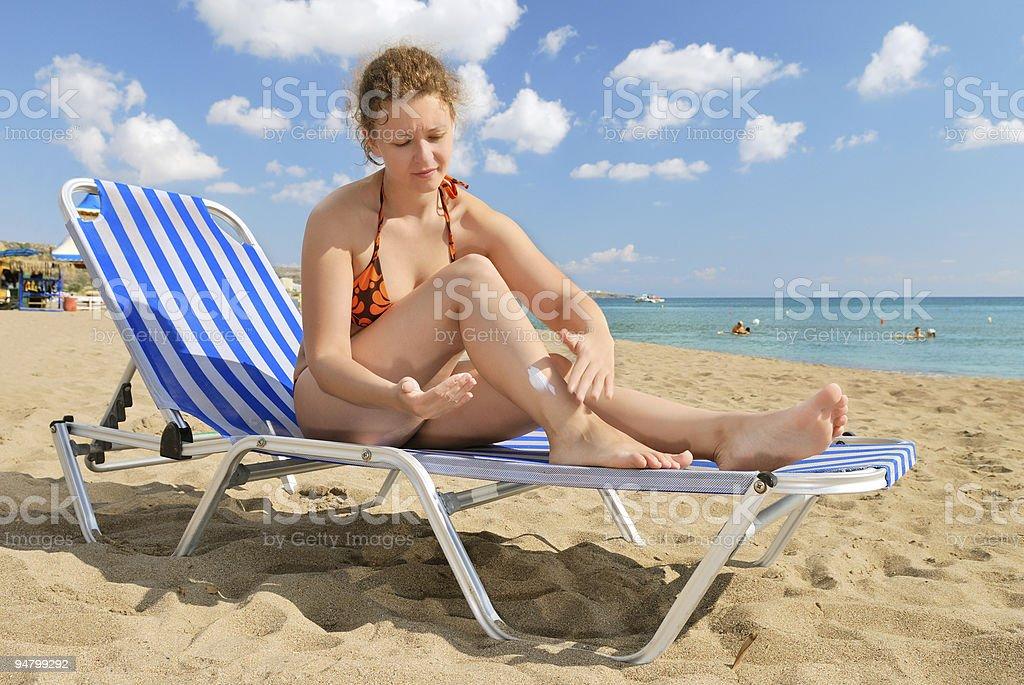 Nice girl with sun-protection cream royalty-free stock photo