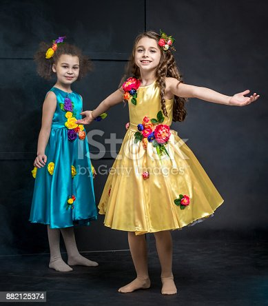 istock Nice Girls in Bright Outfits 882125374