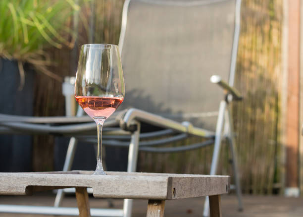 Nice glass of rose wine on a wooden tablet placed in the chillout in picture id1172101456?b=1&k=6&m=1172101456&s=612x612&w=0&h=hv2 pi23rqfxcyfxu2g0vve nazrcr rwohjyf 3hyw=