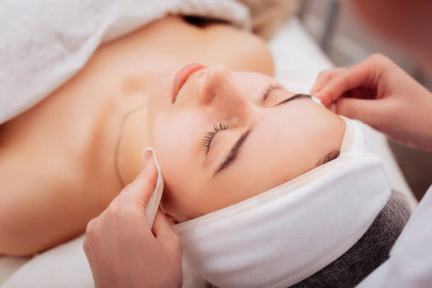 Nice good looking woman visiting a cosmetology clinic Caring about skin. Nice good looking woman visiting a cosmetology clinic while caring about her skin beauty treatment stock pictures, royalty-free photos & images