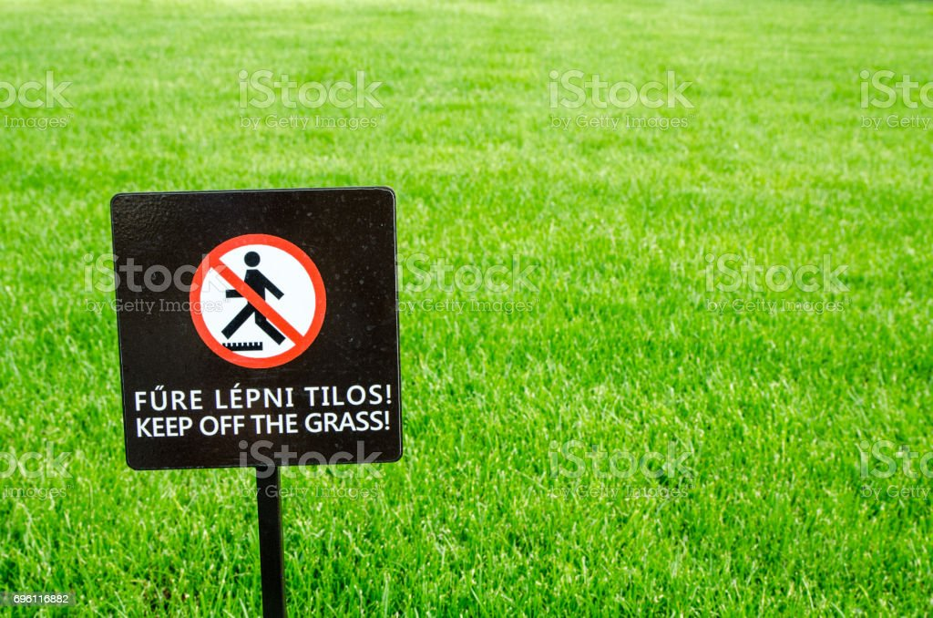 Nice green grass with sign saying to keep off stock photo