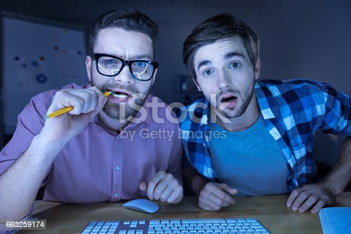 istock Nice handsome men sitting with his friends 663259174