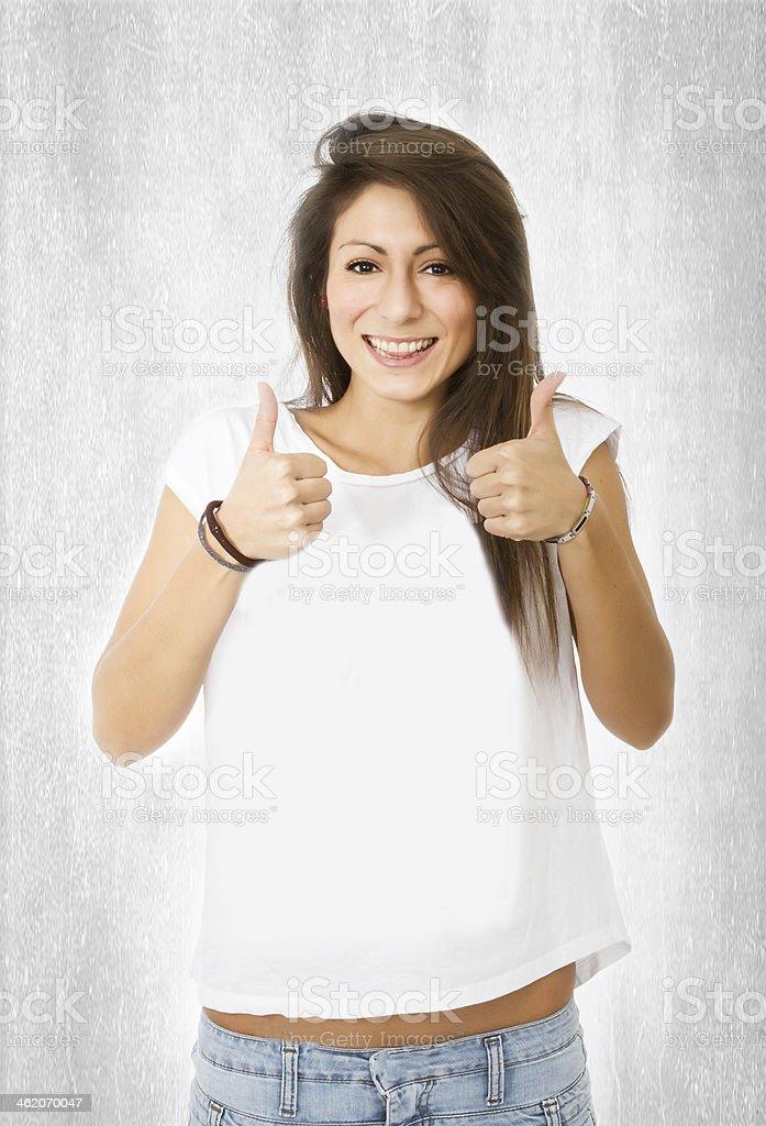 nice hispanic model thumbs up stock photo