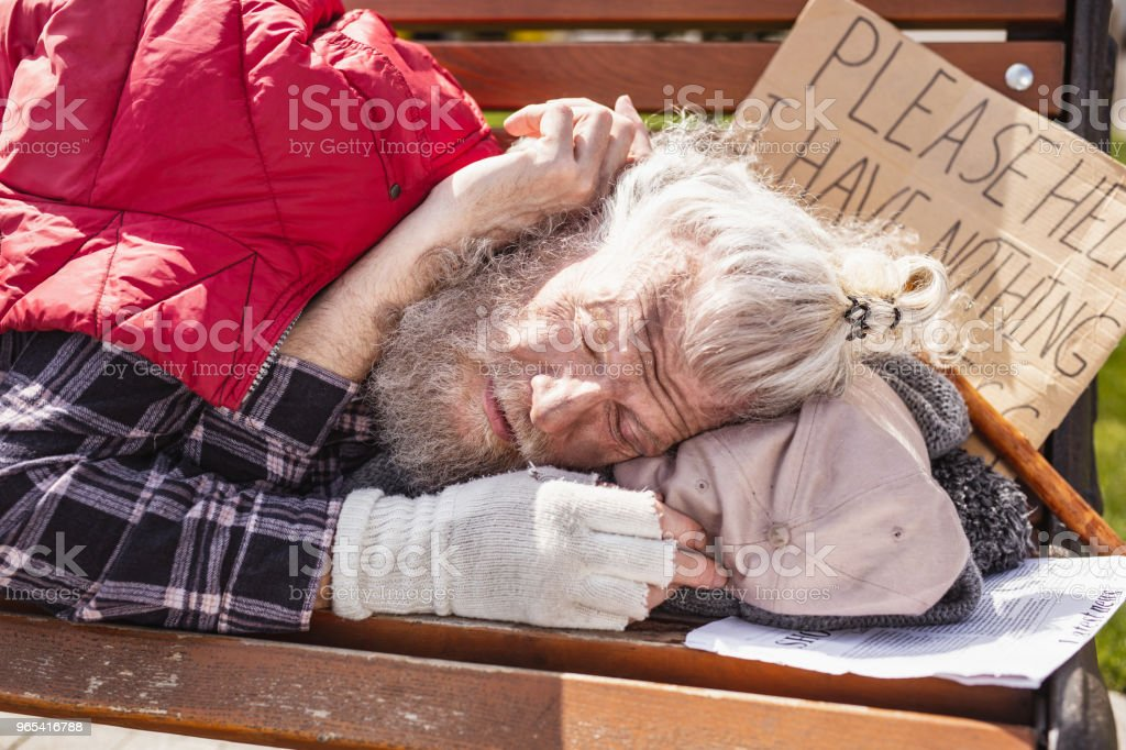 Nice homeless man having nowhere to live zbiór zdjęć royalty-free