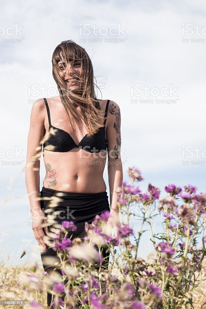 Nice Italian Girl stands in countryside and smiling stock photo