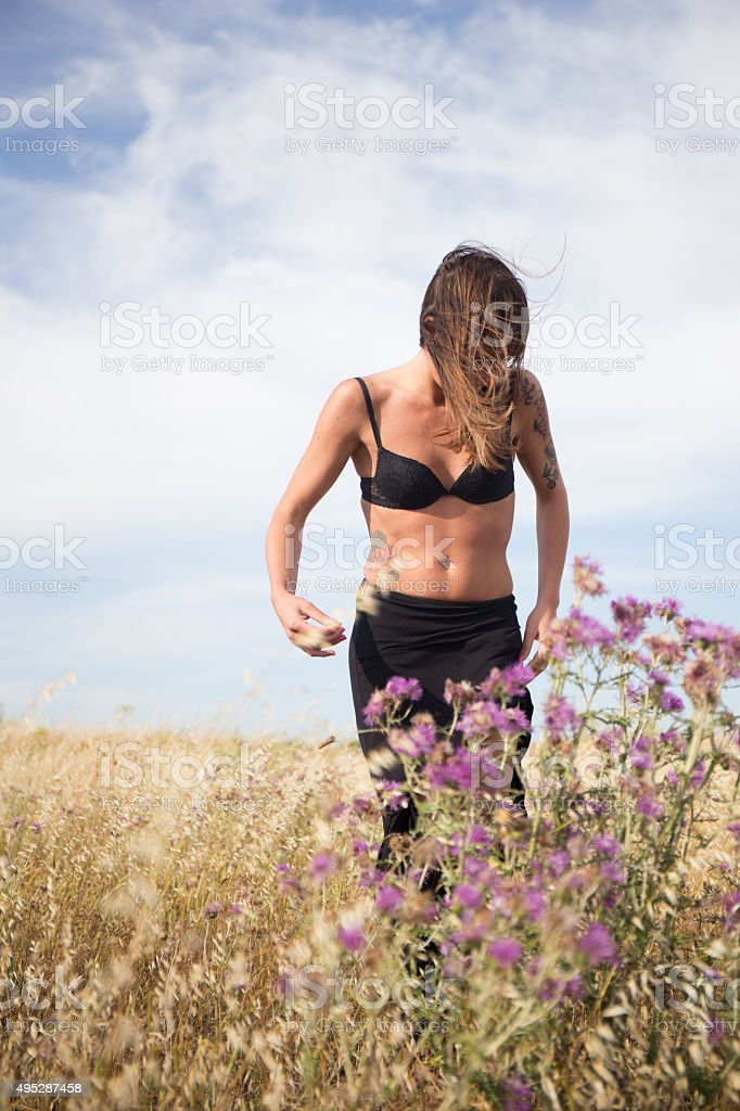 Nice Italian Girl stands in countryside stock photo