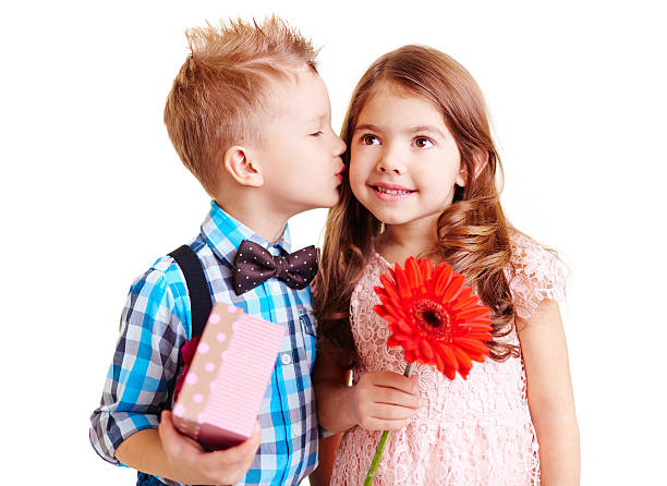 nice kiss - little girls little boys kissing love stock photos and pictures