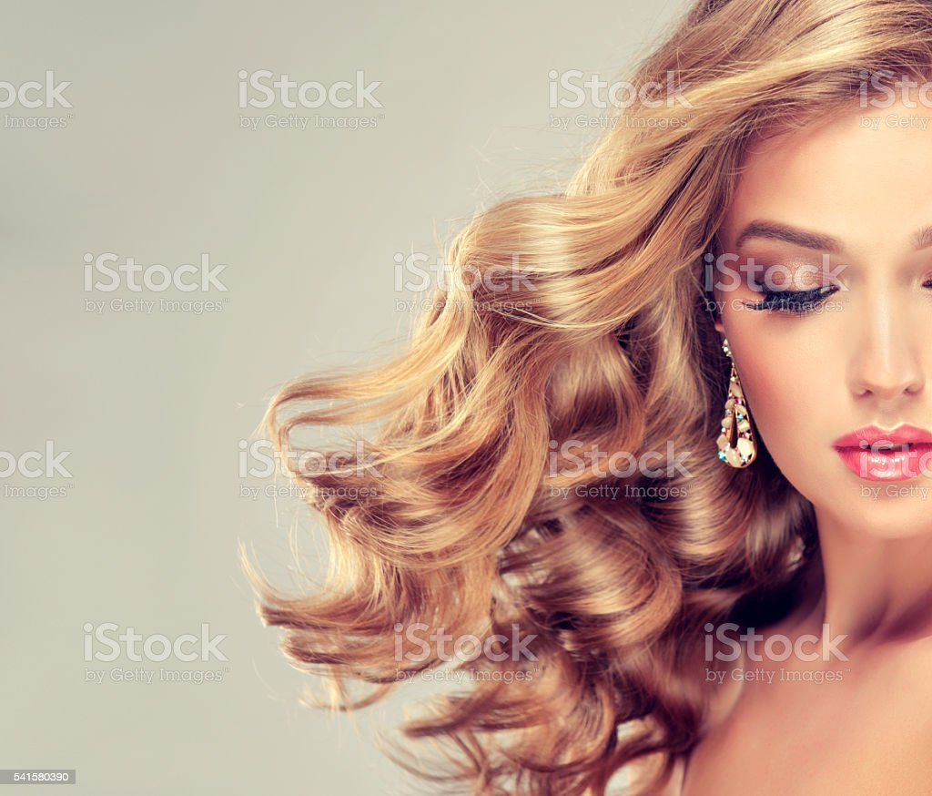 Nice Lady with elegant hairstyle, wavy hair. stock photo