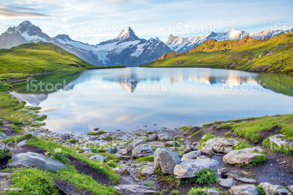 Nice landscape with  lake in the Swiss Alps, Europe. Wetterhorn, Schreckhorn, Finsteraarhorn et Bachsee. ( relaxation, harmony, anti-stress - concept). stock photo