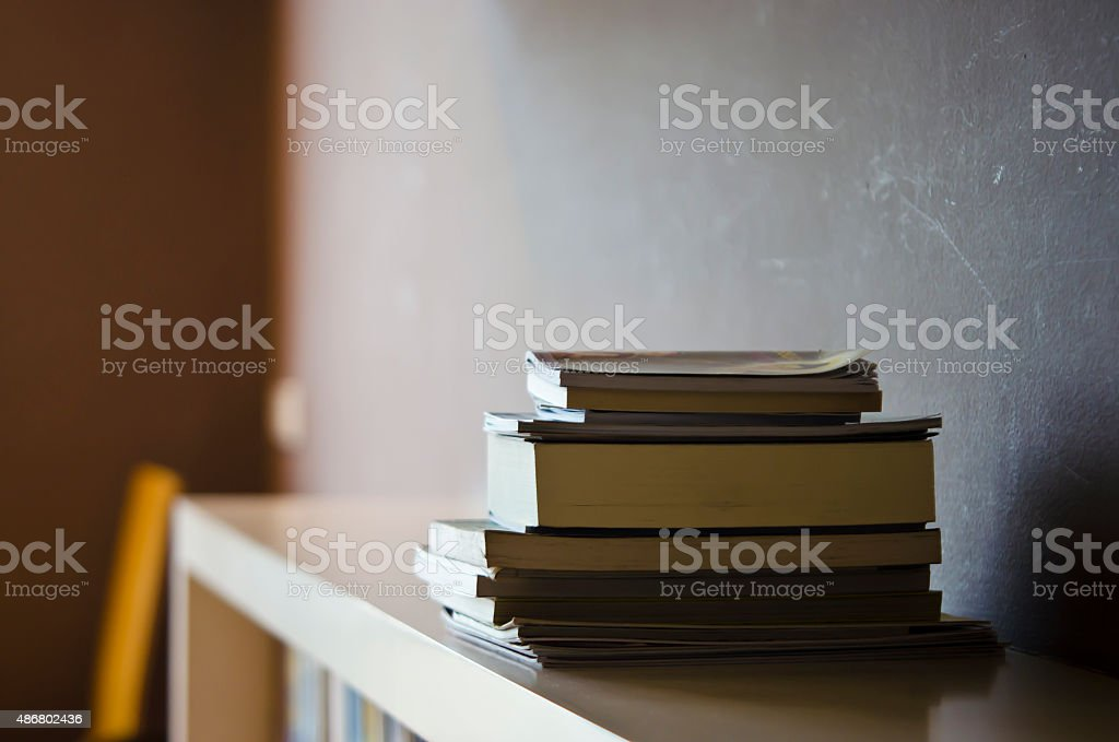 Nice lighting on a book stack with gray background stock photo