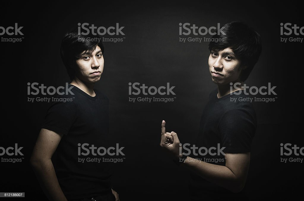 Nice male twins isolated on black background stock photo
