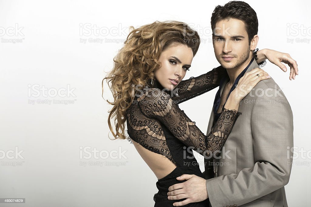 Nice man wearing suit and his blonde girlfriend stock photo
