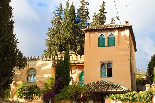 Nice neo-mudejar-looking building un Granada's lovely Albaizín neighborhood on a sunny day