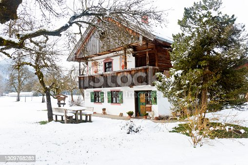 Nice old Bavarian farmhouse with religious paintings. The house was built in 1822 in Bavaria, Germany.