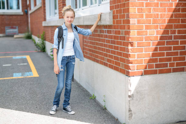Nice Pre-teen boy outside at school having good time stock photo