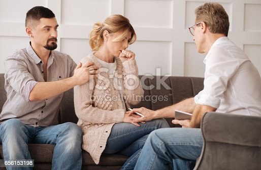 istock Nice professional psychologist calming down a woman 656153198