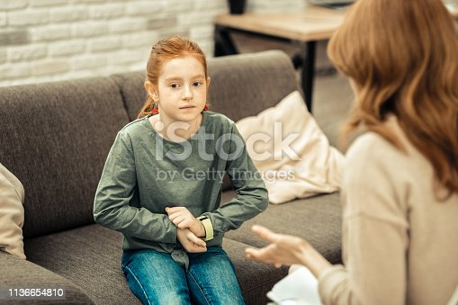 istock Nice red haired girl feeling a bit anxious 1136654810