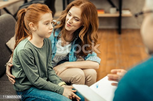 istock Nice sad girl looking in front of her 1136655026
