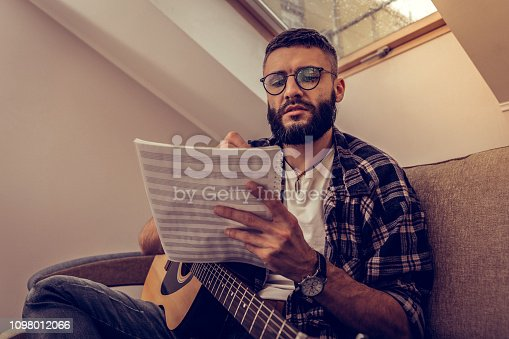 istock Nice serious man looking at the note charts 1098012066