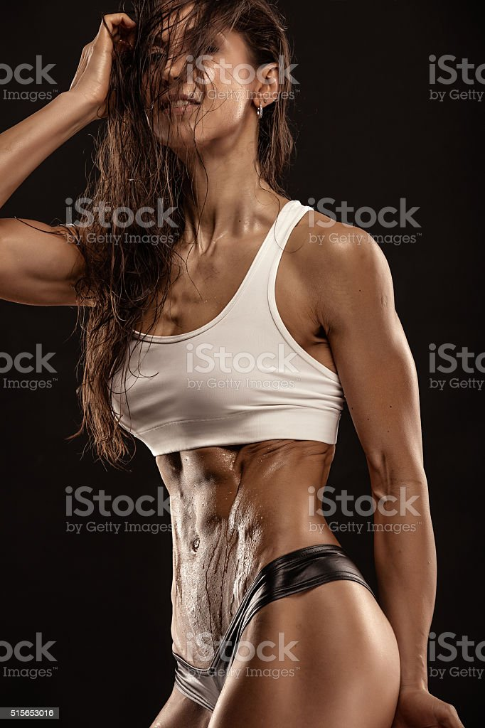 Nice sexy fitness woman showing abdominal muscles stock photo