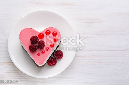 nice small cake in the shape of heart  on the table