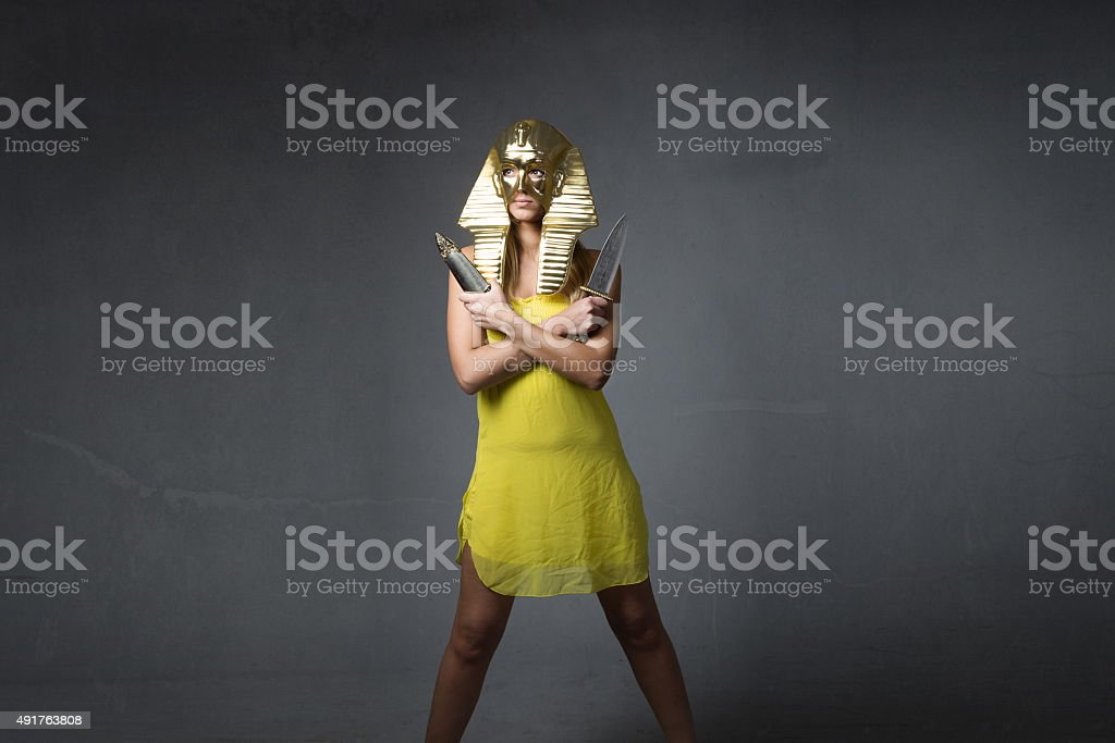 nice sphinx with knifes on hands stock photo