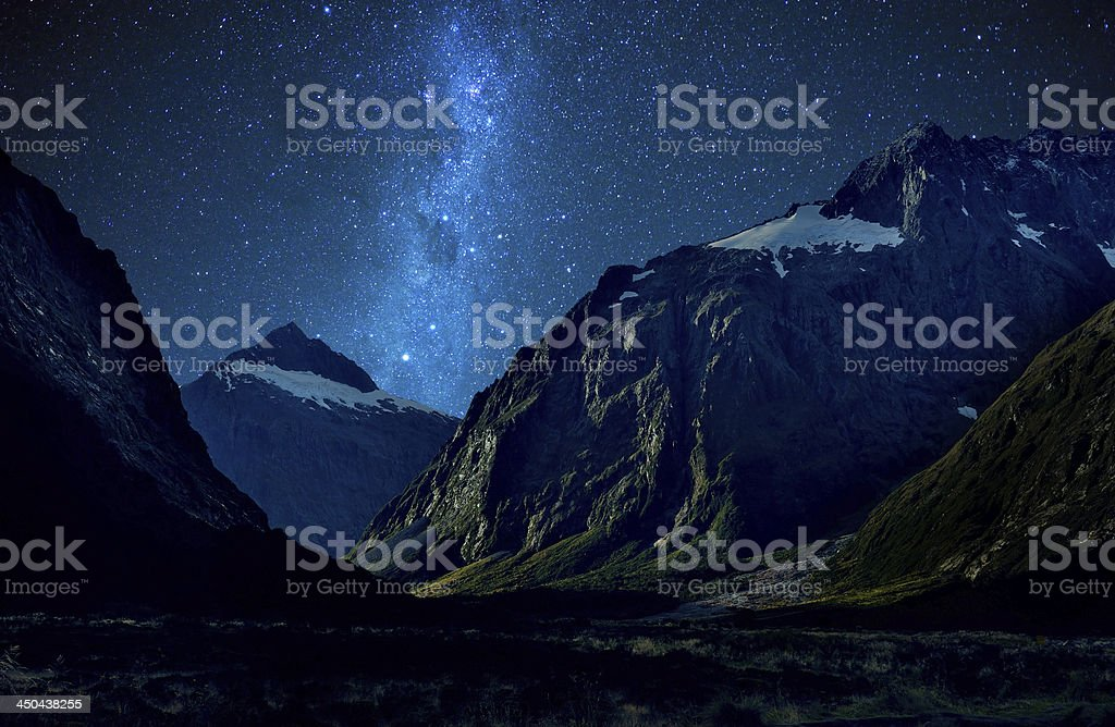 Nice star over mountain at milford sound, New Zealand stock photo
