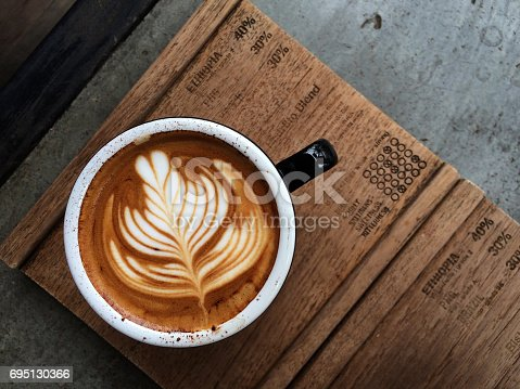 istock Nice Texture of Latte art on hot latte coffee 695130366