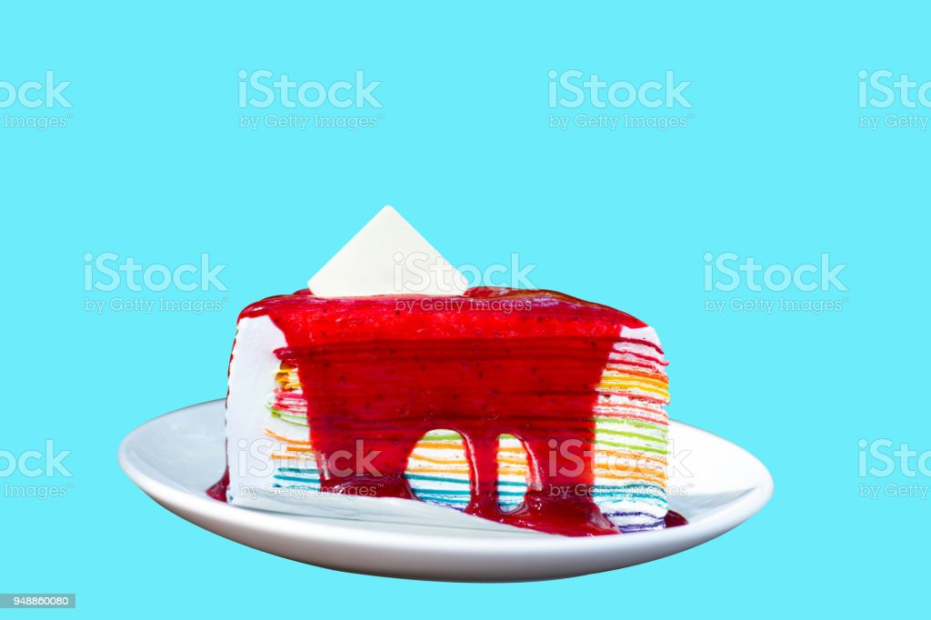 Nice to eat Rainbow Crepe cake with Blank sugar sheet for logo on white dish. isoleted image with clipping path. stock photo