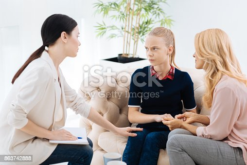 istock Nice unhappy girl looking at her therapist 863742888