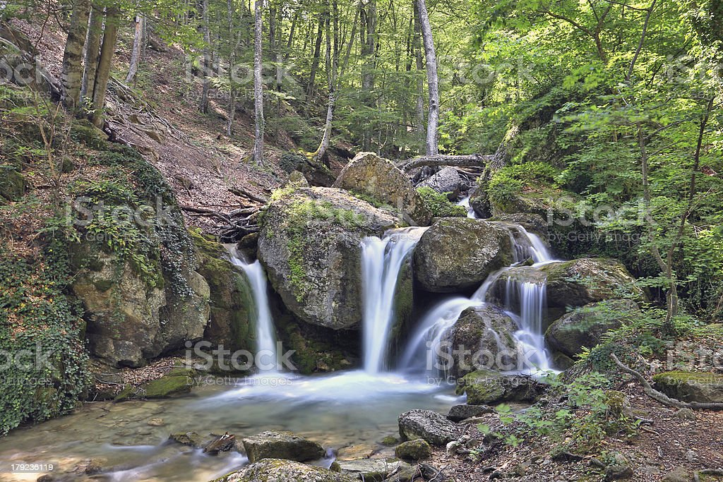 nice waterfall in mountain forest royalty-free stock photo