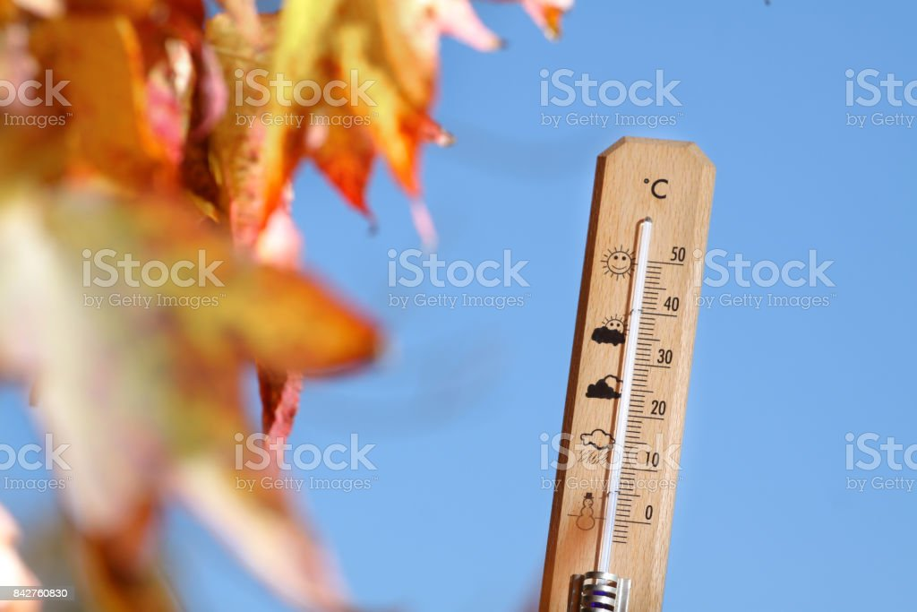 nice weather in the autumn shown with mercury thermometer stock photo