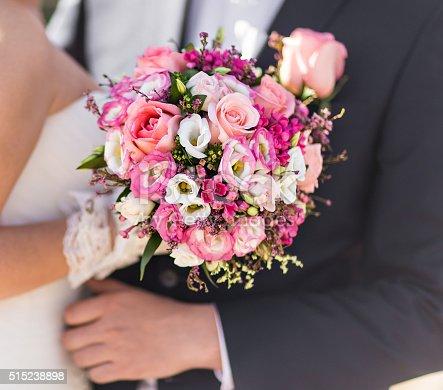 istock nice wedding bouquet in bride's hand 515238898