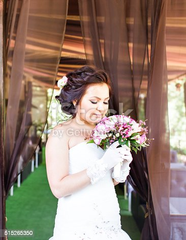 istock nice wedding bouquet in bride's hand 515265350