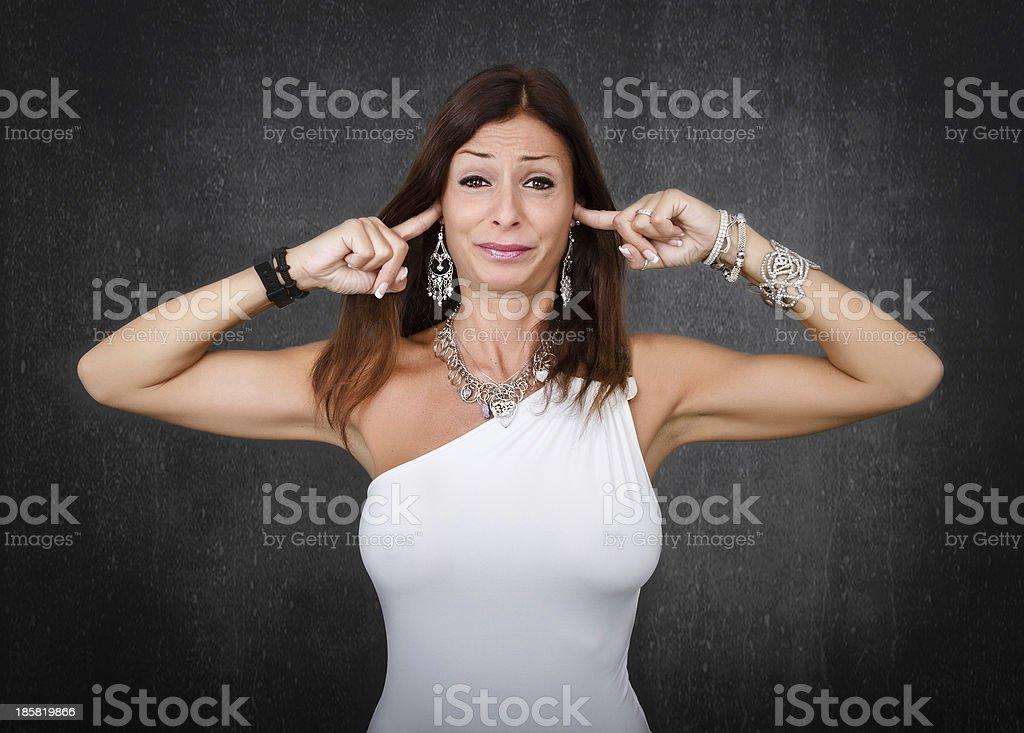 nice woman closing ears royalty-free stock photo
