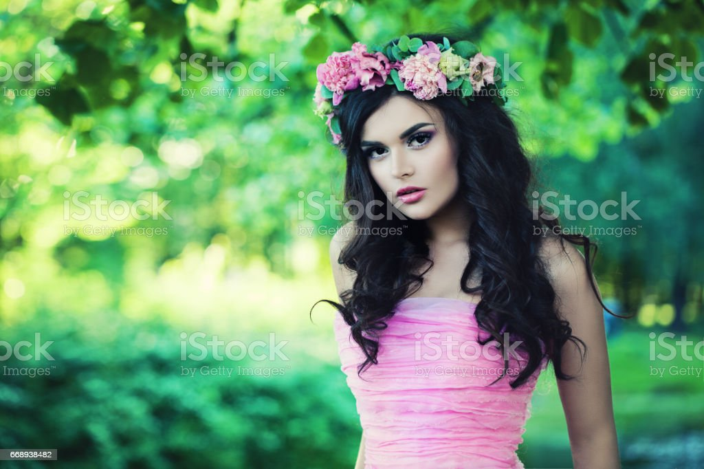 Nice Woman in Spring. Beautiful Model with Flowers stock photo