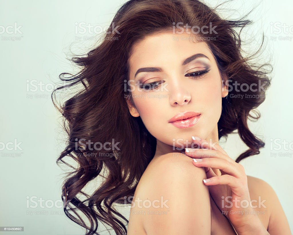 Nice young girl with flying hair. stock photo