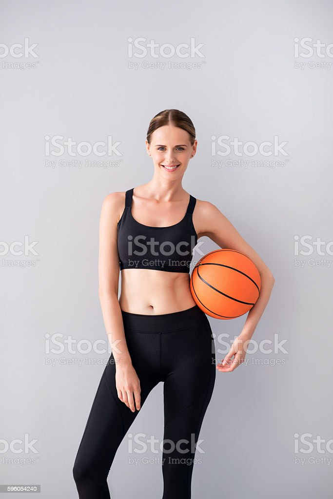 Nice young woman holding ball royalty-free stock photo