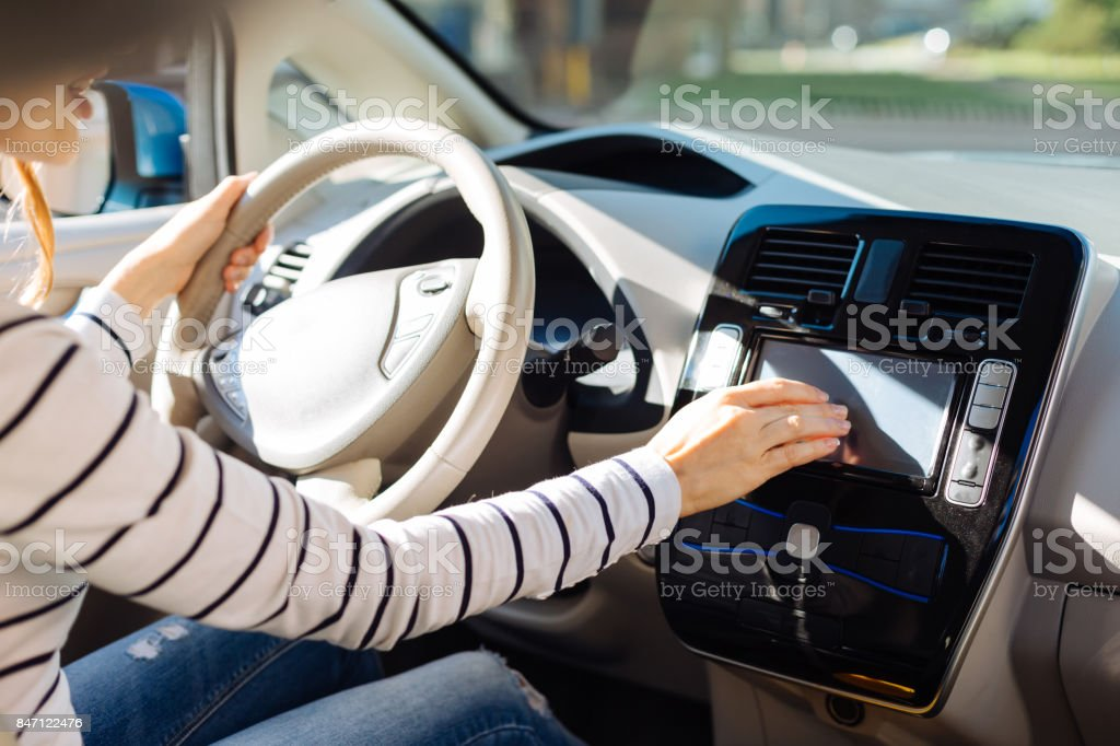 Nice young woman using the control panel stock photo