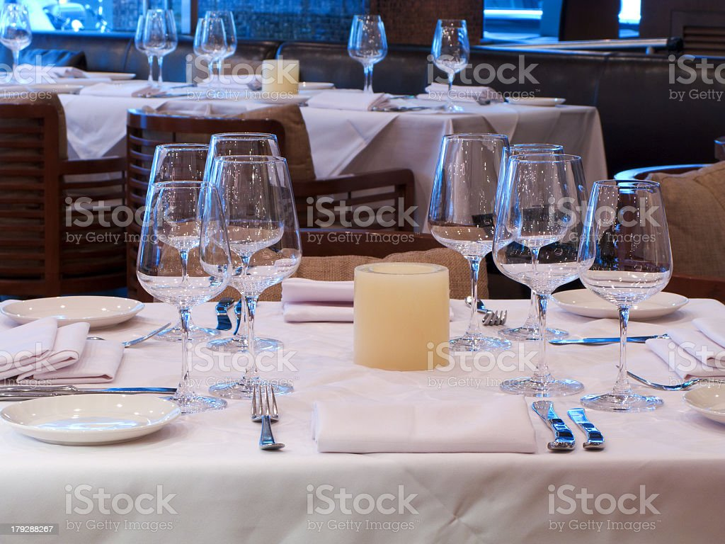 Nicely arranged table at an expensive restaurant royalty-free stock photo