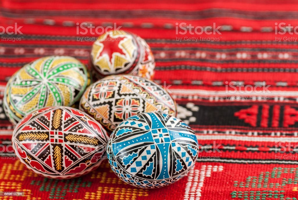 nicely decorated easter eggs on traditional rug stock photo
