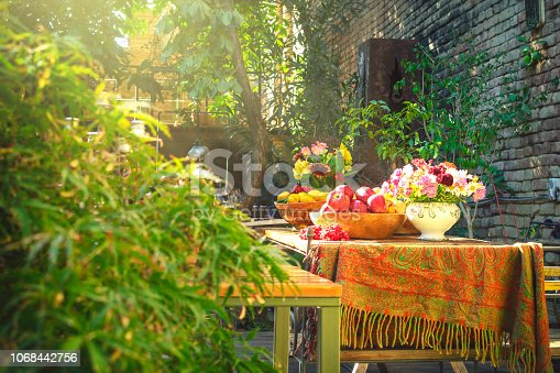 Nicely decorated wooden table full of different kinds of fruits inside shiny beautiful garden
