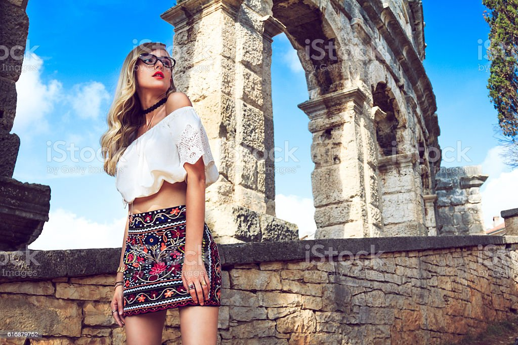 Nicely dressed woman around Roman arena stock photo