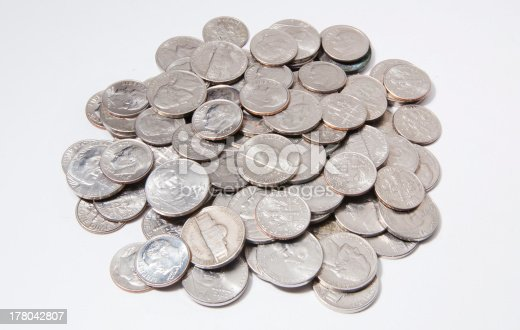 A pile of nickel and dime coins