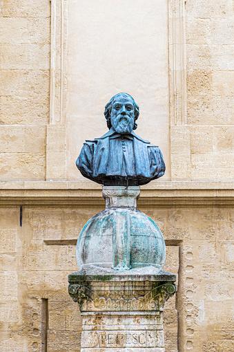Aix en Provence, France - December 15, 2015: Nicolas-Claude Fabri de Peiresc (1 December 1580 – 24 June 1637), was a French astronomer, antiquary and savant. His statue is in the University Square, Aix-en-Provence, France.