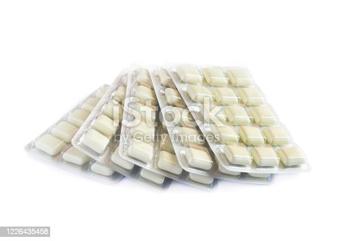 pile of  anti smoking nicotine gum in a package  isolated on a white background