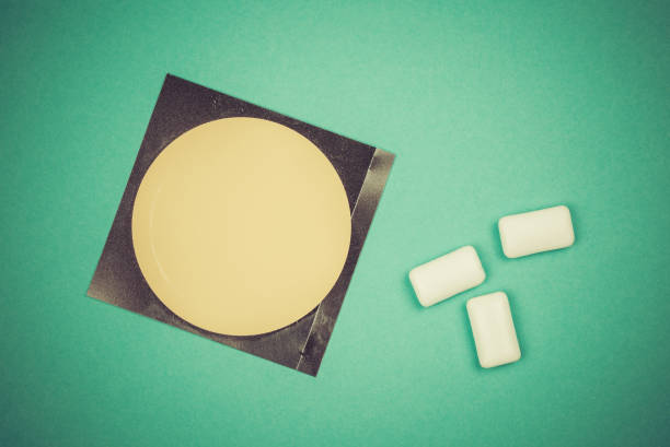 Nicotine patch and chewin gum used for smoking cessation stock photo