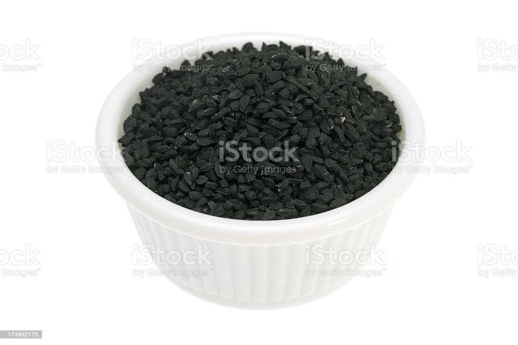Nigella in a small white bowl royalty-free stock photo