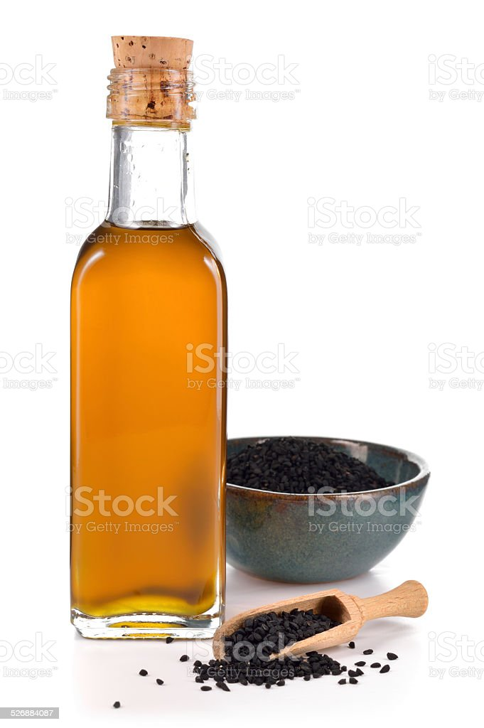 Nigella sativa oil isolated. stock photo